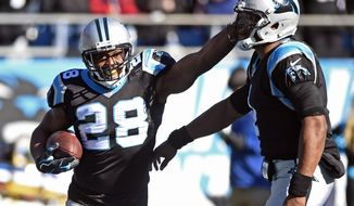FILE - In this Sunday, Dec. 10, 2017, file photo, Carolina Panthers' Jonathan Stewart (28) and Cam Newton (1) celebrate Stewart's touchdown run against the Minnesota Vikings during the first half of an NFL football game in Charlotte, N.C. After a slow start to the season, the 30-year-old running back is starting to heat up after rushing for 103 yards and three touchdowns in a win Sunday against the Vikings.  (AP Photo/Mike McCarn, File)