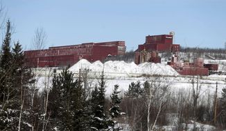 FILE - In this Feb. 10, 2016, file photo, the closed LTV Steel taconite plant sits idle near Hoyt Lakes, Minn. The site, which closed in 2001, may return to life as part of Minnesota's first copper-nickel mine, owned by PolyMet Mining Corp. PolyMet is offering Minnesota a $544 million package of financial assurances to serve as an insurance policy to protect taxpayers from having to cover the costs of shutting down and cleaning up the copper-nickel mine it proposes to build in northeastern Minnesota. (AP Photo/Jim Mone, File)
