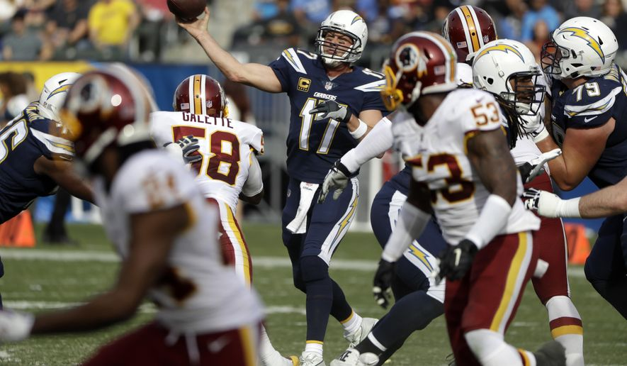 Los Angeles Chargers quarterback Philip Rivers throws a pass during the first half of an NFL football game against the Washington Redskins, Sunday, Dec. 10, 2017, in Carson, Calif. (AP Photo/Alex Gallardo)
