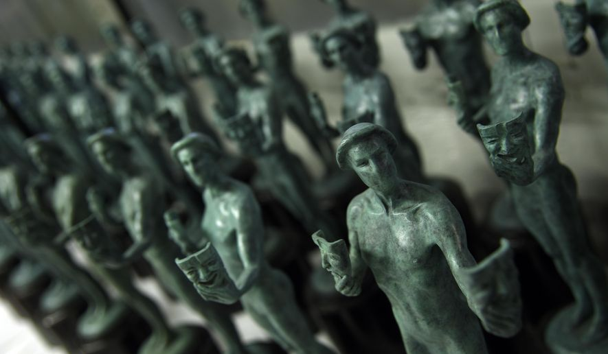 FILE - This Jan. 17, 2017 file photo shows solid bronze Actor statuettes for the Screen Actors Guild awards displayed at the American Fine Arts Foundry in Burbank, Calif. The SAG Awards nominations for achievements in film and television will be announced on Wednesday, Dec. 13. (Photo by Chris Pizzello/Invision/AP, File)