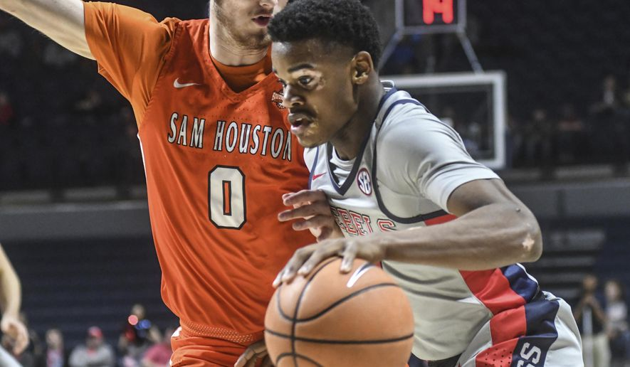 Mississippi's Devontae Shuler (0) drives against Sam Houston State's Albert Almanza (0) during an NCAA college basketball game, Wednesday, Dec. 13, 2017 in Oxford, Miss. (Bruce Newman/The Oxford Eagle via AP)