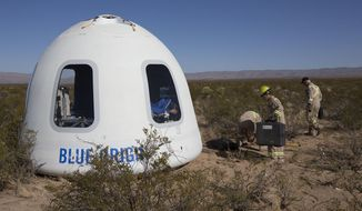This photo provided by Blue Origin shows the New Shepard Crew Capsule 2.0 after landing in west Texas during a test on Tuesday, Dec. 12, 2017. Named after the first American in space, Alan Shepard, the spacecraft made a 10-minute suborbital flight. An instrumented test dummy was aboard, named Mannequin Skywalker. (Blue Origin via AP)