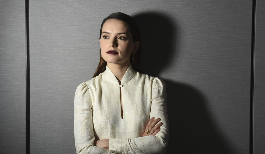 "In this Dec. 3, 2017, photo, actress Daisy Ridley poses for a portrait to promote her film, ""Star Wars: The Last Jedi"" in Los Angeles. (Photo by Jordan Strauss/Invision/AP)"