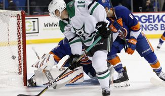 Dallas Stars center Tyler Pitlick (18) watches as his shot goes behind New York Islanders goalie Jaroslav Halak of Slovakia during the first period of an NHL hockey game in New York, Wednesday, Dec. 13, 2017. Islanders defenseman Ryan Pulock (6) watches, right. (AP Photo/Kathy Willens)
