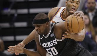 Sacramento Kings forward Zach Randolph, left, drives against Phoenix Suns forward TJ Warren during the second half of an NBA basketball game Tuesday, Dec. 12, 2017, in Sacramento, Calif. The Kings won 99-92. (AP Photo/Rich Pedroncelli)