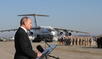Russian President Vladimir Putin addresses the troops at the Hemeimeem air base in Syria, on Monday, Dec. 11, 2017. Declaring a victory in Syria, Putin on Monday visited a Russian military air base in the country and announced a partial pullout of Russian forces from the Mideast nation. (Mikhail Klimentyev, Sputnik, Kremlin Pool Photo via AP)
