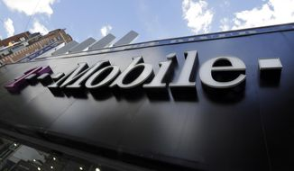 This Wednesday, Oct. 14, 2015, file photo shows a T-Mobile store in New York. (AP Photo/Richard Drew, File)