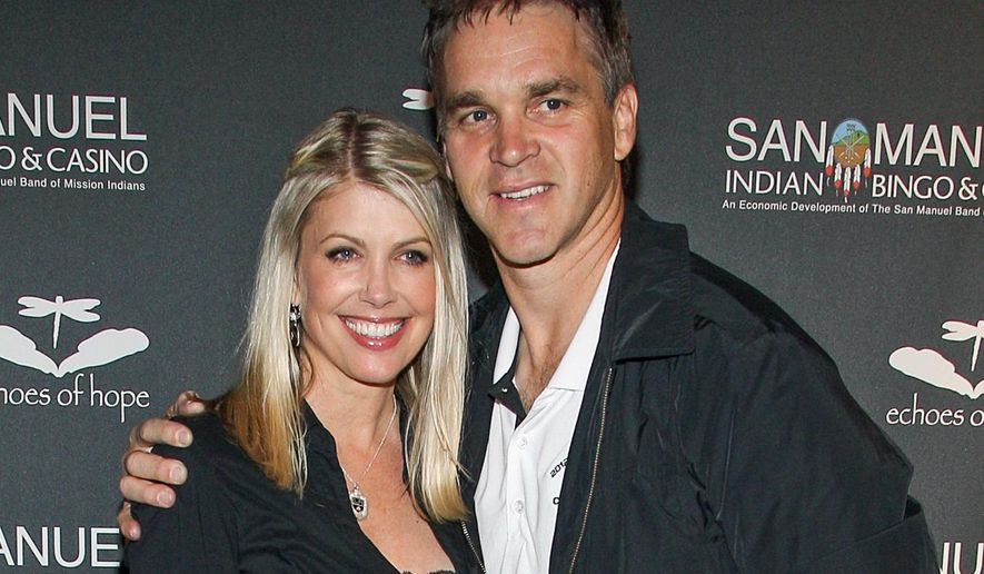 FILE - In this June 23, 2013, file photo, former NHL Player Luc Robitaille and his wife Stacia Robitaille attend Echoes Of Hope's 3rd Annual Luc Robitaille Celebrity Charity Poker Tournament in Los Angeles.  The wife of Hall of Fame hockey player Luc Robitaille has tweeted about an encounter with Donald Trump more than two decades ago in an elevator at Madison Square Garden. (Photo by Paul A. Hebert/Invision/AP, File)