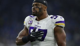 FILE - In this Nov. 23, 2017, file photo, Minnesota Vikings defensive end Everson Griffen (97) stands on the sidelines during an NFL football game against the Detroit Lions, in Detroit. Griffen was only a part-time player for his first four seasons in the league. The last four years, he's become a workhorse defensive end for the Minnesota Vikings and one of the most effective pass rushers in the league. (AP Photo/Jeff Haynes, File)