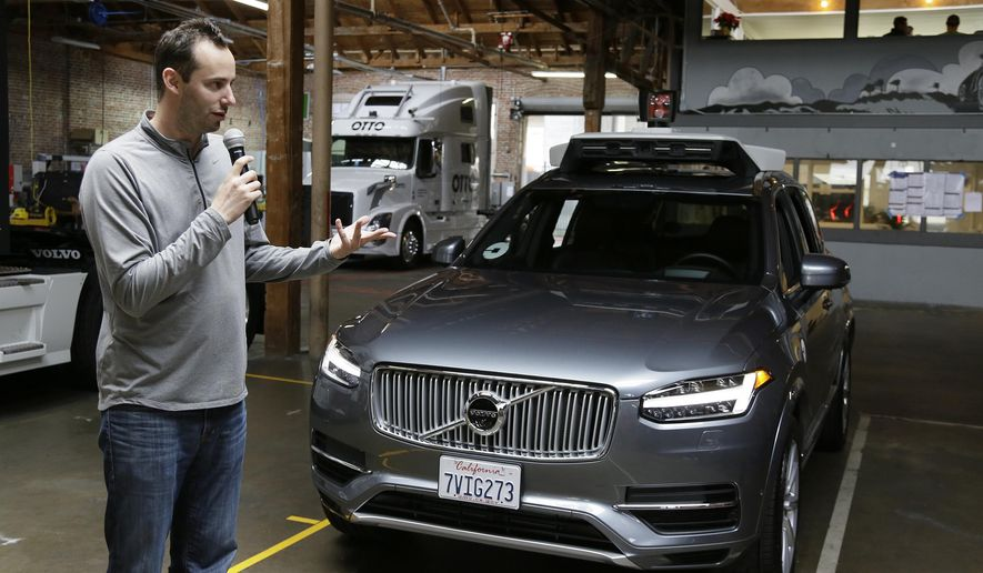 FILE - In this photo taken Tuesday, Dec. 13, 2016, file photo, Anthony Levandowski, then-head of Uber's self-driving program, speaks about their driverless car in San Francisco. A recent letter from the U.S. Attorney's office confirms the Justice Department has opened a criminal investigation connected to allegations that Levandowski, a former Uber executive, stole self-driving car technology from a Google spin-off to help the ride-hailing service build robotic vehicles. (AP Photo/Eric Risberg, File)