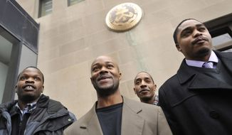 """FILE - In this Jan. 17, 2012 file photo, Harold Richardson, left, Vincent Thames, second from left, Terrill Swift, and Michael Saunders, right, pose for a photo after a hearing in Chicago for the four men known as """"the Englewood Four,"""" whose 1994 rape and murder convictions were overturned in November 2011. New DNA evidence linked another person to the crime. The Chicago City Council approved Wednesday, Dec. 13, 2017, a $31 million settlement to be shared by the men who each spent more than a decade in prison. The police misconduct settlement is one of the largest in the history of the city . (AP Photo/Paul Beaty, File)"""