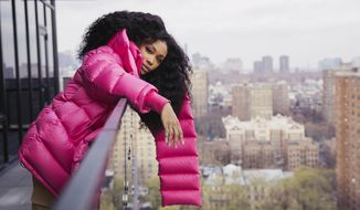 "In this Dec. 4, 2017 photo, SZA poses for a portrait in New York to promote her new album, ""Ctrl."" (Photo by Victoria Will/Invision/AP)"