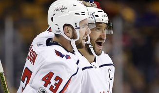 Washington Capitals' Alex Ovechkin is congratulated by Tom Wilson (43) after scoring against the Boston Bruins during the third period of an NHL hockey game in Boston Thursday, Dec. 14, 2017. (AP Photo/Winslow Townson)