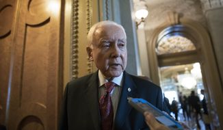 Senate Finance Committee Chairman Orrin Hatch, R-Utah, pauses for a reporter's question on the GOP tax bill as he arrives at the chamber for a vote, on Capitol Hill, in Washington, Thursday, Dec. 14, 2017. (AP Photo/J. Scott Applewhite)