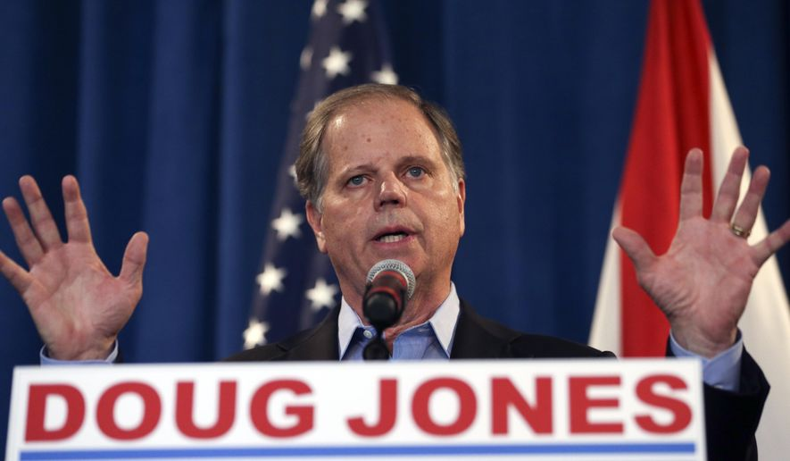 Sen.-elect Doug Jones speaks during a news conference Wednesday, Dec. 13, 2017, in Birmingham, Ala. Weary national Republicans breathed a collective sigh of relief on Wednesday, a day after voters knocked out their own party's scandal-plagued candidate in deep-red Alabama.(AP Photo/John Bazemore)