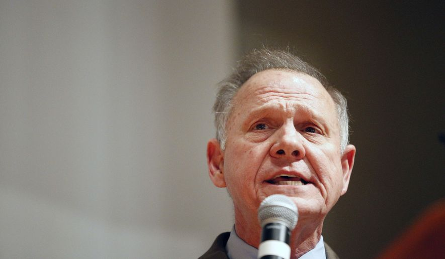 U.S. Senate candidate Roy Moore speaks at the end of an election-night watch party at the RSA activity center, Tuesday, Dec. 12, 2017, in Montgomery, Ala. Moore didn't concede the election to Democrat Doug Jones. (AP Photo/Brynn Anderson)
