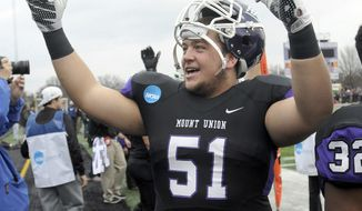 FILE - In this Dec. 12, 2015, file photo, Mount Union lineman Cole Parrish, looks towards the home stands as the final seconds drain from the clock against Wisconsin-Whitewater in the semifinals of an NCAA Division III college football game, in Alliance, Ohio. Mount Union offensive linemen Parrish made the first team on The Associated Press D-III All-America team. (Ed Hall Jr./The Review pm via AP, File)
