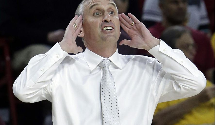 FILE - In this Saturday, Dec 2, 2017, file photo, Arizona State head coach Bobby Hurley reacts to a call in the first half of an NCAA college basketball game against San Francisco in Tempe, Ariz. Arizona State was picked to finish sixth in the Pac-12, its rise expected to come next season, coach Bobby Hurley's fourth in the desert. The breakneck Sun Devils have spun the narrative forward a year early, thrusting themselves into the national spotlight with a road victory over Kansas and a No. 5 ranking.(AP Photo/Rick Scuteri, File)