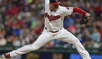 FILE - In this Aug. 4, 2017 file photo, Cleveland Indians relief pitcher Joe Smith delivers in the eighth inning of a baseball game against the New York Yankees, in Cleveland. Smith and the World Series champion Houston Astros have agreed to a $15 million, two-year contract. The 33-year-old gets $7 million next year and $8 million in 2019.  (AP Photo/David Dermer, File)