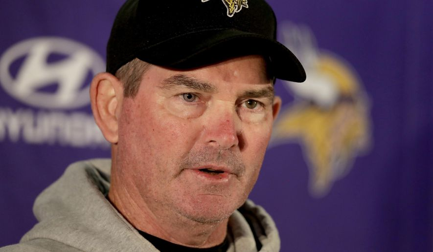 FILE - In this Oct. 27, 2017, file photo, Minnesota Vikings head coach Mike Zimmer speaks to the media after an NFL training session at the London Irish rugby team training ground in the Sunbury-on-Thames suburb of south west London. Zimmer was a beloved defensive coordinator for the Cincinnati Bengals for six years, before finally getting his first chance to be a head coach with the Minnesota Vikings in 2014. He'll face his former team in a regular-season game for the first time on Sunday, Dec. 17. (AP Photo/Matt Dunham, File)
