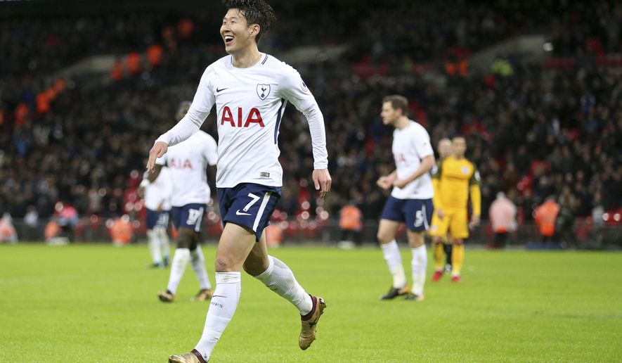Tottenham Hotspur's Son Heung-Min celebrates scoring his side's second goal of the game against Brighton & Hove Albion during their English Premier League soccer match at Wembley Stadium in London, Wednesday Dec. 13, 2017. (Nigel French/PA via AP)