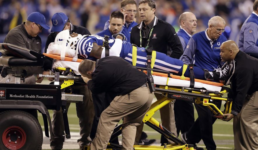 Indianapolis Colts tight end Brandon Williams (85) is taken off the field after being injured during the first half of an NFL football game against the Denver Broncos in Indianapolis, Thursday, Dec. 14, 2017. (AP Photo/Darron Cummings)