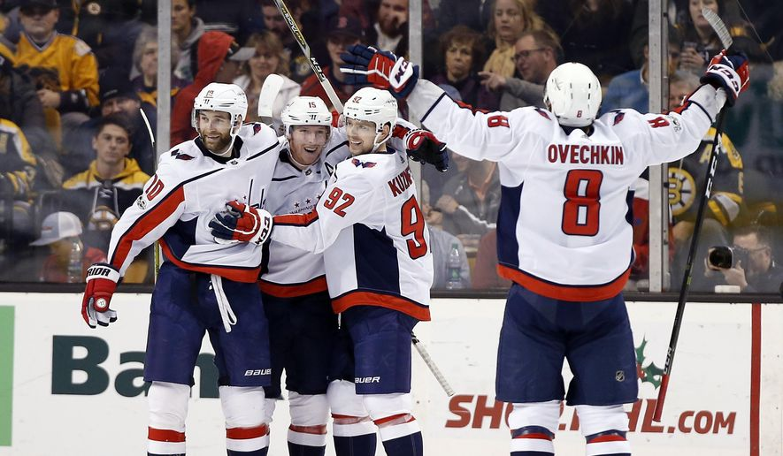 Washington Capitals' Nicklas Backstrom, center, celebrates his goal against the Boston Bruins with Brett Connolly (10), Evgeny Kuznetsov (92) and Alex Ovechkin during the second period of an NHL hockey game in Boston Thursday, Dec. 14, 2017. (AP Photo/Winslow Townson)