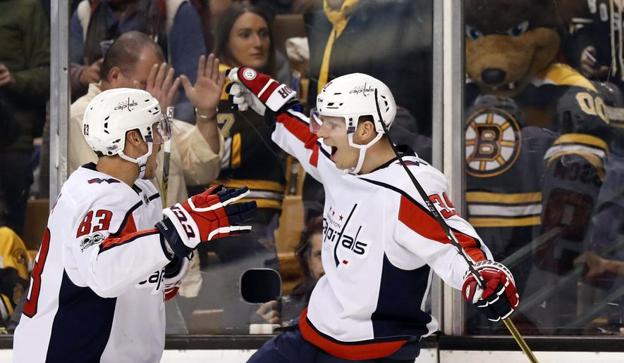 "As the Boston Bruins mascot ""Blades the Bruin"" looks on, Washington Capitals' Alex Chiasson celebrates his unassisted, shorthanded goal with teammate Jay Beagle, left, during the third period of Washington's 5-3 win over the Boston Bruins in an NHL hockey game in Boston Thursday, Dec. 14, 2017. (AP Photo/Winslow Townson)"