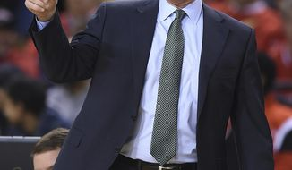 FILE - In this Dec. 20, 2016, file photo, Charlotte coach Mark Price calls to his team during the first half of an NCAA college basketball game against Maryland in Baltimore. The Charlotte 49ers fired Price on Thursday, Dec. 14, 2017. The 53-year-old Price, who was a four-time NBA All-Star guard, was in his third season with the 49ers and had a 30-42 record overall. He  was 16-20 in Conference USA play. (AP Photo/Gail Burton, File)