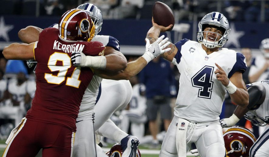 FILE - In this Nov. 30, 2017, file photo, Washington Redskins linebacker Ryan Kerrigan (91) pressures Dallas Cowboys quarterback Dak Prescott (4) as Prescott throws a pass in the second half of an NFL football game, in Arlington, Texas. The Cowboys face the Oakland Raiders on Sunday, Dec. 17. (AP Photo/Michael Ainsworth, File)