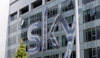 FILE - This Friday, July 25, 2014, file photo shows a view of the headquarters of the Italian Sky television broadcaster in Milan, Italy. Disney announced Thursday, Dec. 14, 2017, that it is buying a large part of Fox. Under the deal, Disney will get at least a 39 percent stake in European satellite-TV and broadcaster Sky. Fox is hoping to acquire the remainder of Sky before the deal closes, giving Disney full control. (AP Photo/Luca Bruno, File)