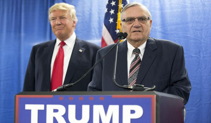 FILE - In this Jan. 26, 2016, file photo, then-Republican presidential candidate Donald Trump is joined by Joe Arpaio, the then sheriff of metro Phoenix, during a news conference in Marshalltown, Iowa. Jurors at a malicious-prosecution trial against former Sheriff Arpaio were told the lawman brought a trumped-up criminal case against one of Sen. Jeff Flake's sons to garner publicity for himself. (AP Photo/Mary Altaffer, File)