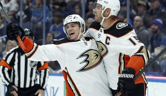 Anaheim Ducks' Kevin Roy, left, is congratulated by teammate Ryan Getzlaf after scoring during the third period of an NHL hockey game against the St. Louis Blues, Thursday, Dec. 14, 2017, in St. Louis. (AP Photo/Jeff Roberson)