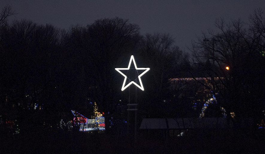 In this Dec. 2017 photo, a 24-foot aluminum star fabricated by Bessler Welding stands 50 feet  above VFW Park in East Peoria's Winter Wonderland in East Peoria, Ill., to honor Alan Henricks' mother Cecelia, a longtime volunteer for the city's Festival of Lights, who died in September. (Matt Dayhoff/Journal Star via AP)