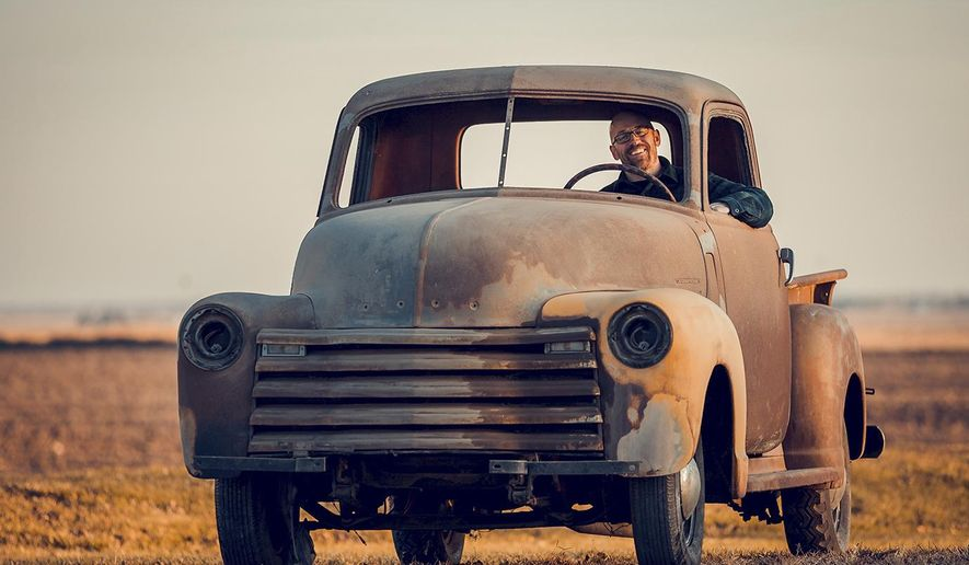In this Dec. 2017 photo, Leland Wingert sits in a 1950 Chevrolet 3100 pickup truck that used  to belong to his father Wendell Wingert who purchased it after returning home from Viet Nam. The Bronze Star recipient often picked up his wife, Mary, in the truck when they were dating. When they had kids, it sat on their Bonfield farm until they sold it to a neighbor almost 30 years ago. But, the old, rusted-up truck is back in the family again. Wendell's son, Leland, recently bought it back from a farmer for $1,000. (John Dykstra/The Daily Journal via AP)