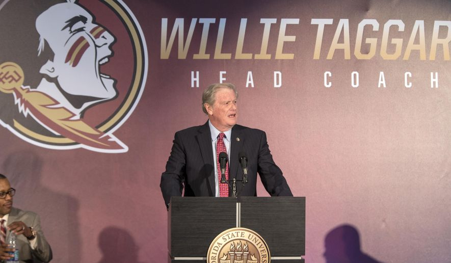 In this Wednesday, Dec. 6, 2017, Florida State University president John Thrasher delivers remarks before introducing Willie Taggart as FSU's new NCAA college football coach during a news conference in Tallahassee, Fla. (AP Photo/Mark Wallheiser)