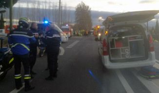 In this photo provided by France Bleu, rescue workers help after a school bus and a regional train collided in the village of Millas, southern France, Thursday, Dec. 14, 2017. A school bus and a regional train collided in southern France on Thursday, killing four children and critically injuring several other people on the bus, the French interior ministry said. (France Bleu via AP)