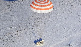 The Russian Soyuz MS-05 space capsule lands about 150 km (90 miles) south-east of the Kazakh town of Zhezkazgan, Kazakhstan, Thursday, Dec. 14, 2017. Three astronauts on Thursday landed back on Earth after nearly six months aboard the International Space Station. (AP Photo/Dmitri Lovetsky, Pool)