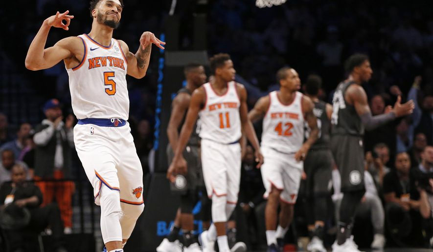 New York Knicks guard Courtney Lee (5) celebrates after hitting a three-point basket in the fourth quarter of an NBA basketball game against the Brooklyn Nets, Thursday, Dec. 14, 2017, in New York. (AP Photo/Kathy Willens)