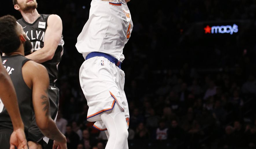 New York Knicks forward Kristaps Porzingis (6) dunks in front of Brooklyn Nets center Tyler Zeller (44) in the first half of an NBA basketball game, Thursday, Dec. 14, 2017, in New York. (AP Photo/Kathy Willens)