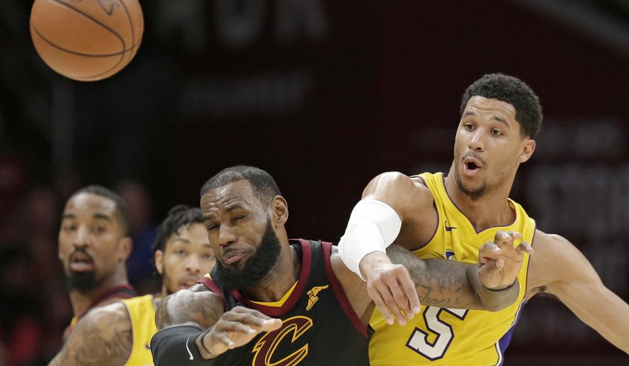 Cleveland Cavaliers' LeBron James, front left, and Los Angeles Lakers' Josh Hart, right, battle for the ball in the second half of an NBA basketball game, Thursday, Dec. 14, 2017, in Cleveland. (AP Photo/Tony Dejak)