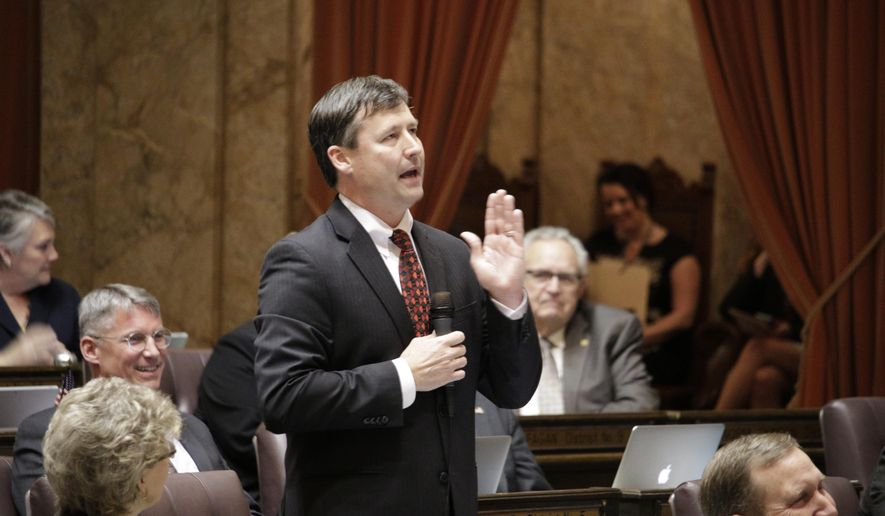 FILE - In this March 3, 2015 file photo, Rep. Matt Manweller, R-Ellensburg, speaks on the House floor in Olympia, Wash., against a bill to raise Washington state's minimum wage. Manweller, who is facing scrutiny over past allegations of sexual harassment, has been removed from his ranking member position on a House committee, and has resigned his position as assistant floor leader, House leaders said Thursday, Dec. 14, 2017. (AP Photo/Rachel La Corte, File)