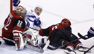 Arizona Coyotes defenseman Jakob Chychrun (6) and Tampa Bay Lightning right wing Ryan Callahan, middle, collide into Coyotes goalie Antti Raanta (32) during the first period of an NHL hockey game, Thursday, Dec. 14, 2017, in Glendale, Ariz. (AP Photo/Ross D. Franklin)