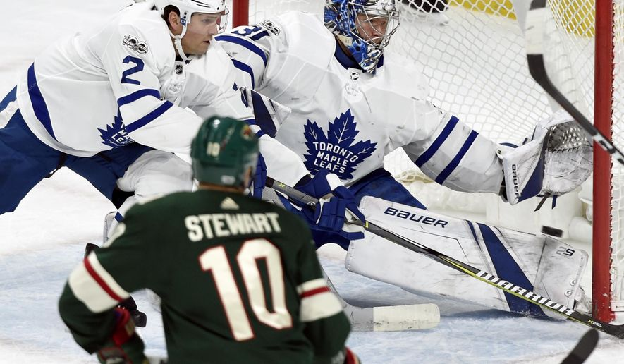 Minnesota Wild left wing Tyler Ennis, not pictured, scores a goal past Toronto Maple Leafs defenseman Ron Hainsey (2) and goalie Frederik Andersen (31), of Denmark, as Minnesota Wild right wing Chris Stewart (10) watches during the first period of an NHL hockey game Thursday, Dec. 14, 2017, in St. Paul, Minn. (AP Photo/Hannah Foslien)