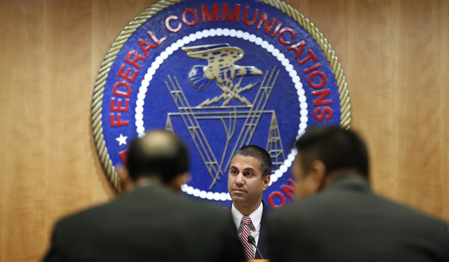 Federal Communications Commission (FCC) Chairman Ajit Pai takes his seat for an FCC meeting where they will vote on net neutrality, Thursday, Dec. 14, 2017, in Washington. (AP Photo/Jacquelyn Martin)