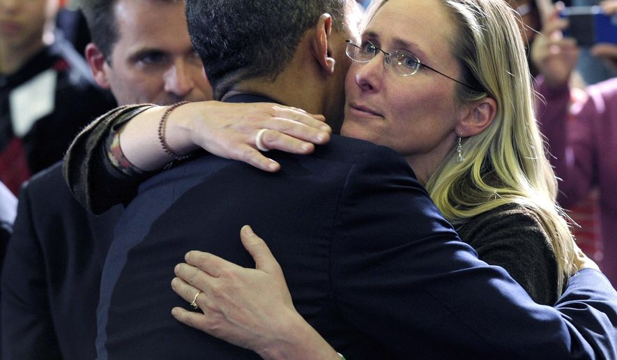 FILE - In this April 8, 2013, file photo, President Barack Obama embraces Scarlett Lewis, mother of Sandy Hook Elementary School shooting victim Jesse Lewis, after speaking at in Hartford, Conn. Her Jesse Lewis Choose Love Movement has developed its own social-emotional learning curriculum being used on a pilot basis in four schools in Connecticut, Hawaii, Arkansas and New Mexico. (AP Photo/Susan Walsh, File)