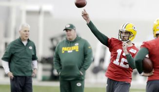 Green Bay Packers quarterback Aaron Rodgers (12) throws during practice at the Don Hutson Center on Wednesday, Dec. 13, 2017 in Ashwaubenon, Wis.   (Adam Wesley/The Post-Crescent via AP)