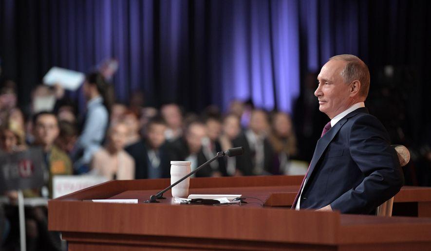 Russian President Vladimir Putin speaks during his annual news conference in Moscow, Russia, Thursday, Dec. 14, 2017. (Mikhail Klimentyev, Sputnik, Kremlin Pool Photo via AP)