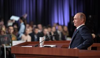 Russian President Vladimir Putin speaks during his annual news conference in Moscow, Russia, Thursday, Dec. 14, 2017. (Mikhail Klimentyev, Sputnik, Kremlin Pool Photo via AP)