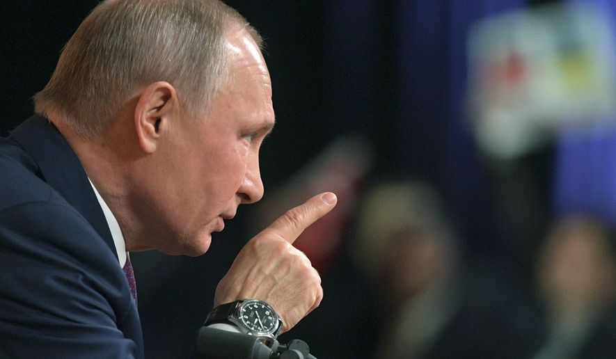 Russian President Vladimir Putin gestures during his annual news conference in Moscow, Russia, Thursday, Dec. 14, 2017. (Alexei Druzhinin, Sputnik, Kremlin Pool Photo via AP)
